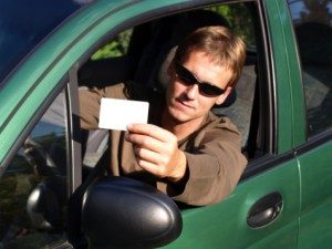 man with driver license 300x225 Military Members: Make Sure Your Drivers License is Valid