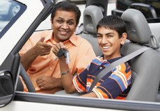 Middle Eastern father and son in new car